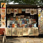 A stand of a bouquiniste (french term for second-hand books resellers) , in Paris, near the Cathedral Notre-Dame of Paris. Bouquinistes can be considered a landmark of Paris. There are nearly 250 of them, mainly located in the central area of the city, alongside the banks of the Seine river.